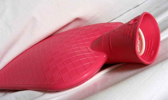 применение грелки для грыжи позвоночника